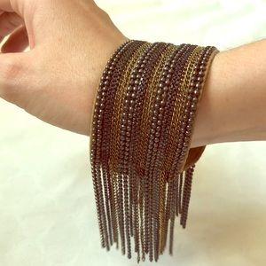 Leather bracelet with metal dangling beads &chains